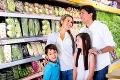 Family at the supermarket Stock Images