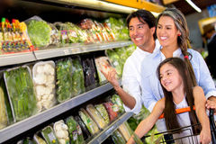 Family at the supermarket Stock Image