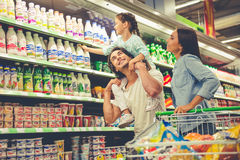 Family in the supermarket Stock Image
