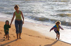 Family on surf beach royalty free stock image