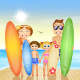 Family with surf on the beach Stock Photo