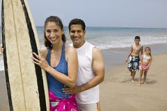 Family with Surfboard on Beach Royalty Free Stock Photo