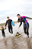 Family of Surfers Royalty Free Stock Image