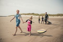 Family Surfing Holiday Stock Image