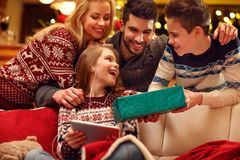 Family surprise girl with gift on Christmas day. Family surprise happy girl with gift on Christmas day Stock Image