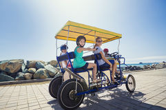 Family on a surrey bike ride along the coast of California Stock Photos