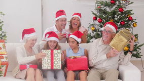 Family swapping christmas presents Royalty Free Stock Photos