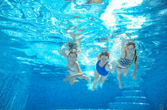 Family swim in pool or sea underwater, mother and children have fun in water Stock Photography