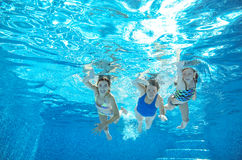 Family swim in pool or sea underwater, mother and children have fun in water Stock Images