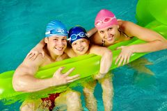 Family of swimmers Royalty Free Stock Photos