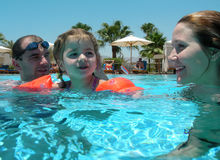 Family swimming Stock Image