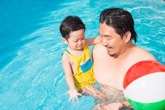 Family swimming Stock Images