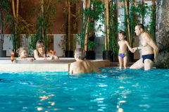 Family in swimming-pool Royalty Free Stock Photography