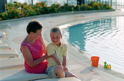 Family before swimming pool royalty free stock images