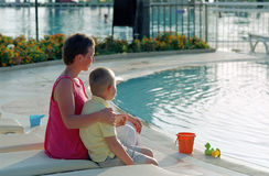 Family before swimming pool Royalty Free Stock Photography
