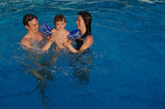 Family in swimming pool Stock Photo
