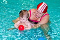 Family in the swimming pool Royalty Free Stock Images