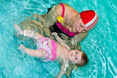 Family in the swimming pool Stock Photos