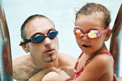 Family in swimming pool. Father and daughter in swimming pool Stock Photo