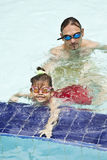 Family in swimming pool. Father and daughter in swimming pool Stock Photography
