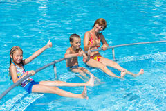 Family in the swimming pool. Stock Photos