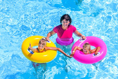 Family in swimming pool. Family with children on beach ring in swimming pool. Summer outdoor Stock Image