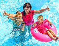 Family in swimming pool. Royalty Free Stock Photos