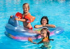 Family in swimming pool. Family with children in swimming pool. Summer outdoor Royalty Free Stock Photo
