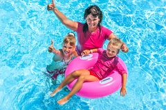 Family in swimming pool. Family with children in swimming pool. Summer outdoor Stock Images