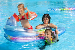 Family in swimming pool. Family with children in swimming pool. Summer outdoor. Floating mattress stock photography