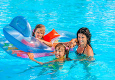 Family in swimming pool. Family with children in swimming pool. Three people on summer outdoor Stock Photography