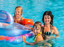 Family in swimming pool. Happy family  in swimming pool. Summer outdoor Stock Photos