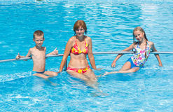 Family in the swimming pool. Royalty Free Stock Images