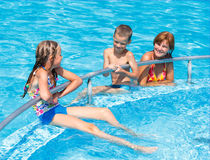 Family in the swimming pool. Stock Photography