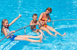 Family in the swimming pool. Stock Images