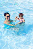 Family in swimming pool playing Royalty Free Stock Images