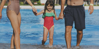 Family Swimming Pool Playing Togetherness Summer Holiday Royalty Free Stock Image