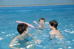 Family in swimming pool Stock Images