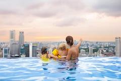 Kids swim in Singapore roof top swimming pool Royalty Free Stock Photos