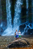 Family swimming in waterfall Royalty Free Stock Photos