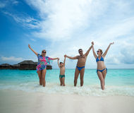 Family swims against the beautiful tropical island royalty free stock photography