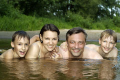 Family swims in the river Stock Photo