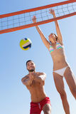 Family in swimwear playing with a ball Royalty Free Stock Photo