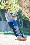 Family at swings Stock Photography