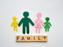 Family symbol mad with paper and text FAMILY woodenblock on whit stock photo