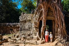 Family at Ta Som temple. Family mother and child visiting ancient Ta Som temple in Angkor Archeological area in Cambodia stock images
