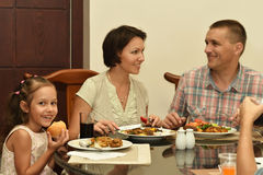 Family at the table Royalty Free Stock Photos