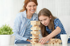 Family at the table playing board game Stock Image