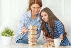 Family at the table playing board game Stock Photography