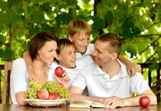 Family at table in summer Royalty Free Stock Images